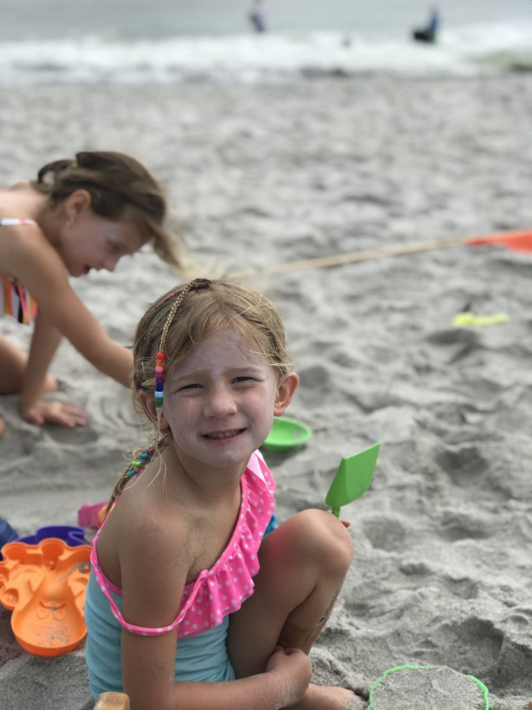 Playing in the sand and building castles on Cocoa Beach | The Champagne Supernova